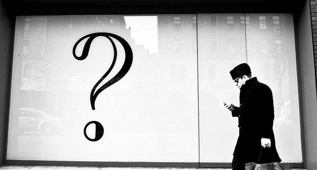 man-walking-with-phone